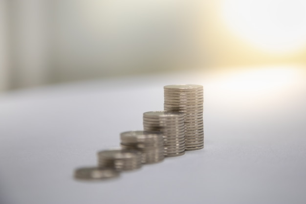 Close up of stack of silver coins with copy space. Premium Photo
