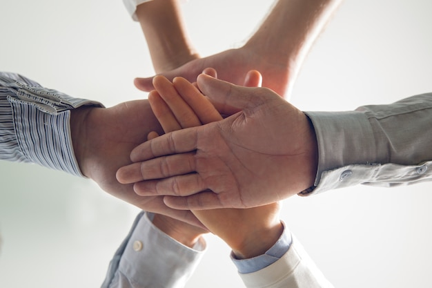 Close-up of stacked hands of business team Free Photo