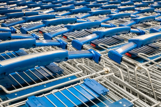 Close-up stacked shopping cart in department store. Premium Photo