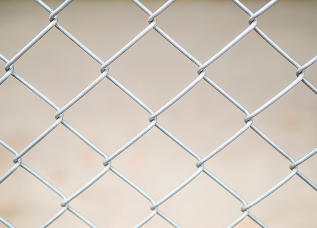 Close up of steel wire mesh fence background Free Photo