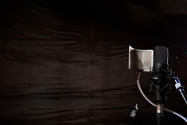 Close up studio condenser microphone with pop filter and anti-vi Premium Photo