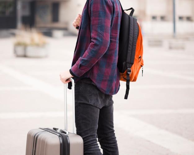 Close-up stylish tourist with luggage Free Photo