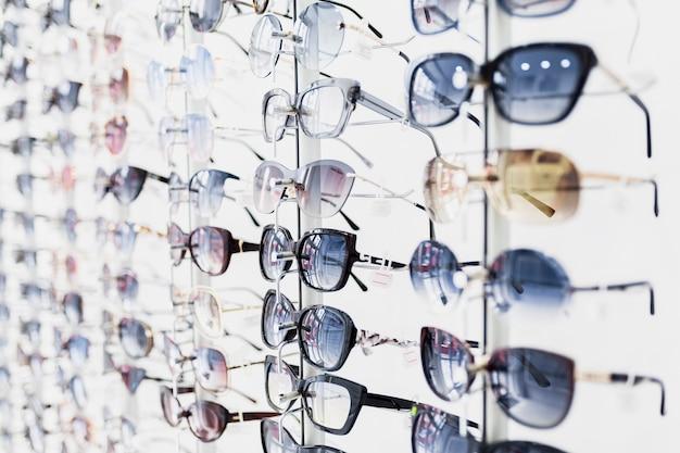 Close-up of sunglasses pairs on display Free Photo