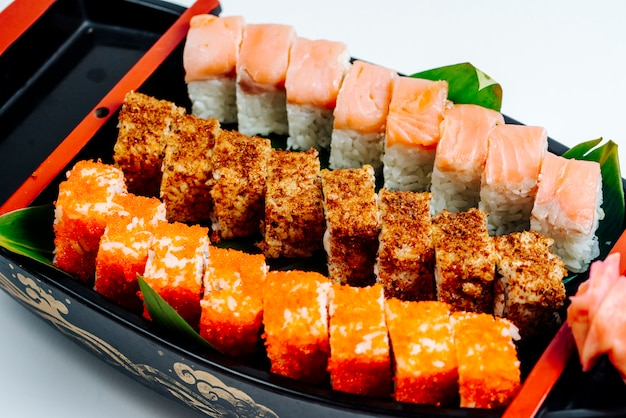 Close up of sushi set with hot and cold rolls Free Photo