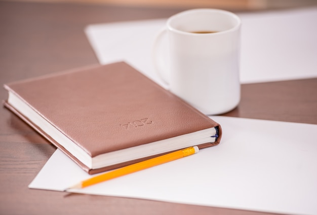 Close-up of table in business office with diary. Premium Photo
