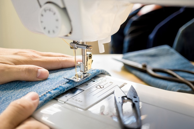 Close up of tailor's hand working Premium Photo