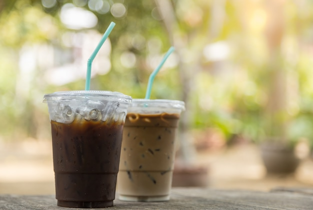 Close up of take away plastic cup of iced black coffee ...