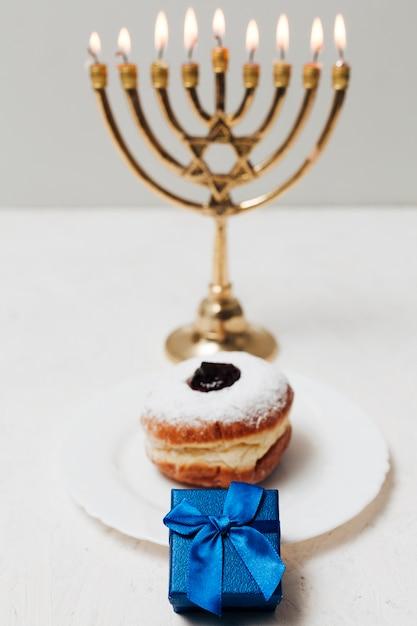 Close-up tasty donut and a menorah Free Photo