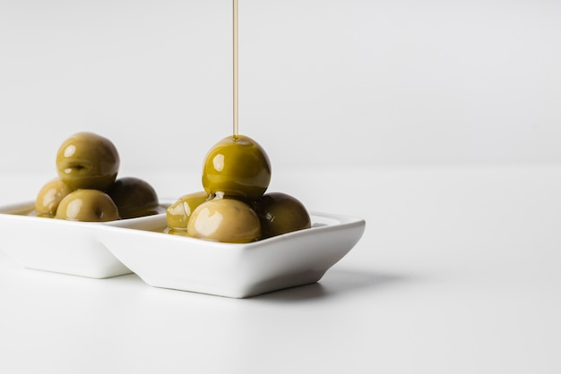 Close-up tasty olives ready to be served Free Photo