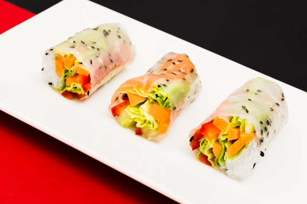 Close-up of tasty steamed rice spring rolls on white place Free Photo