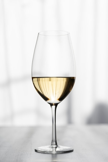 Close-up of tasty white wine glass Free Photo