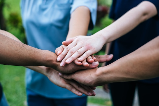 Close up team students teamwork stack hands together. startup, success concept. Free Photo