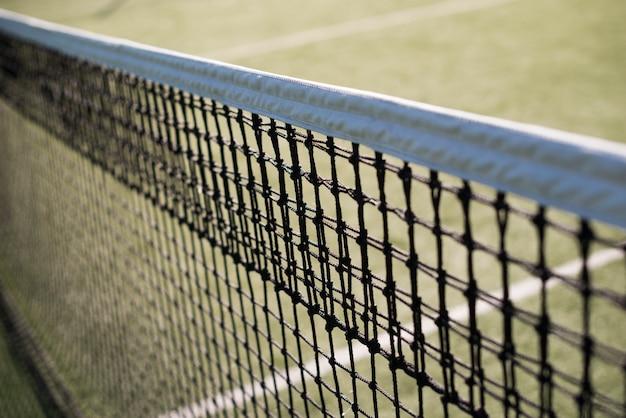 Close-up tennis net in a tennis court Free Photo