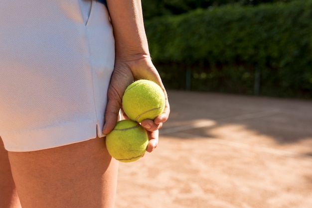 Close-up of tennis player with sport equipment Free Photo