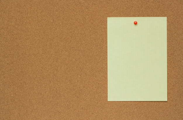 Close-up texture of a brown cork board sheet with a sheet of paper Premium Photo
