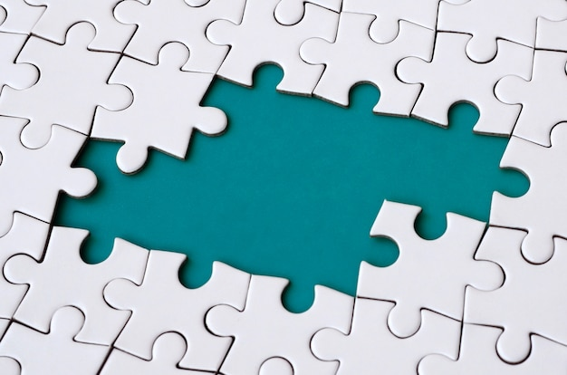Close-up texture of a white jigsaw puzzle in assembled state Premium Photo