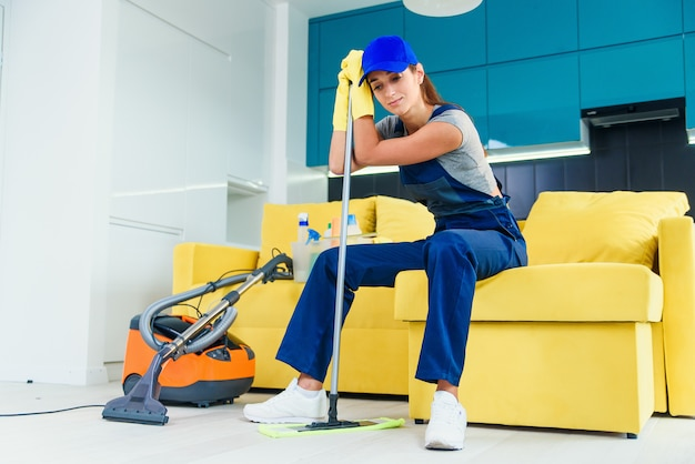 Close-up of a tired woman after house work Premium Photo