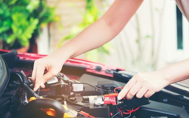 Close up tool and women hand of mechanic car repair during investigate cause of problem Premium Photo