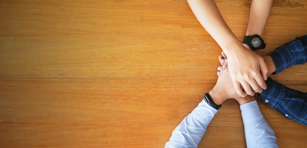 Close up top view of young business people putting their hands together. team job. startup concept Premium Photo