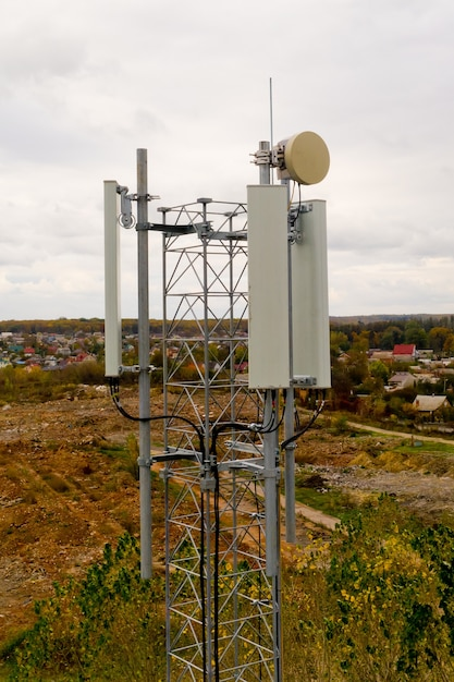 Close-up of tower with 5g and 4g cellular network antenna. aerial view. Premium Photo