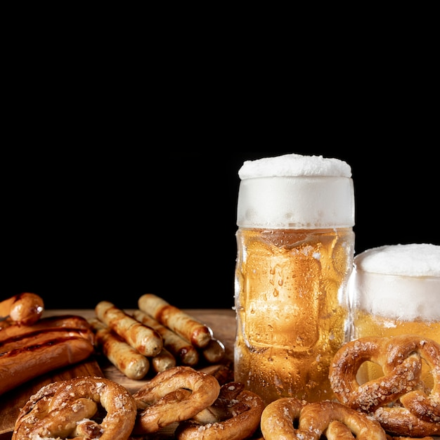 Close-up traditional bavarian beer and snacks Free Photo