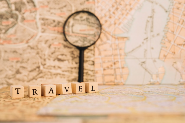 Close-up travel writing near magnifying glass nd maps Free Photo