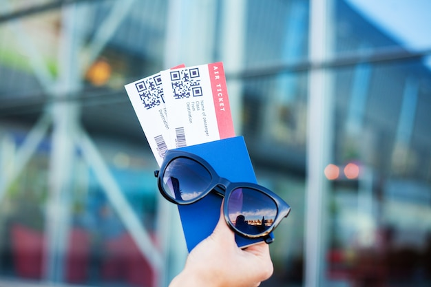 Close up two air ticket in abroad passport near airport Premium Photo