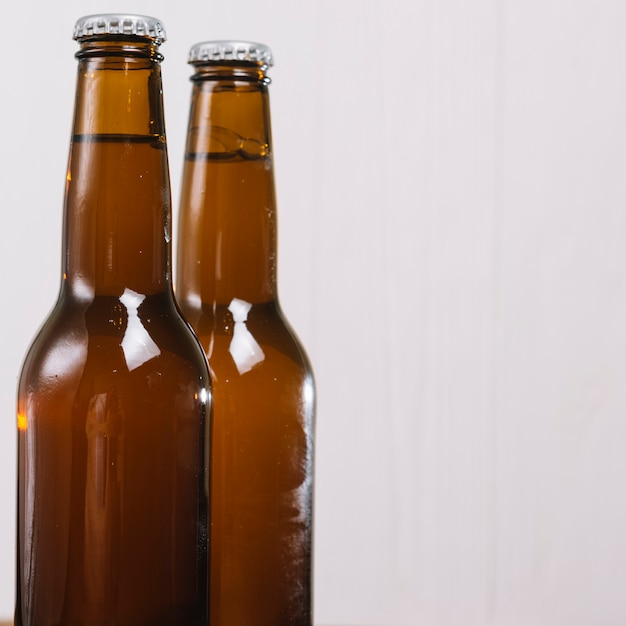 Close-up of two beer bottles Free Photo