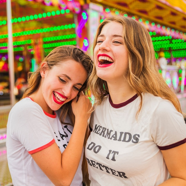 Close-up of two happy female friends Free Photo