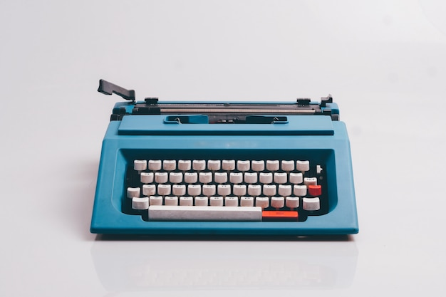 Close up typewriter on white background. Premium Photo