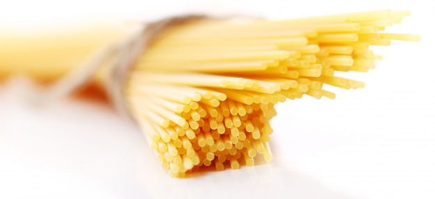 Close up of uncooked spaghetti Free Photo