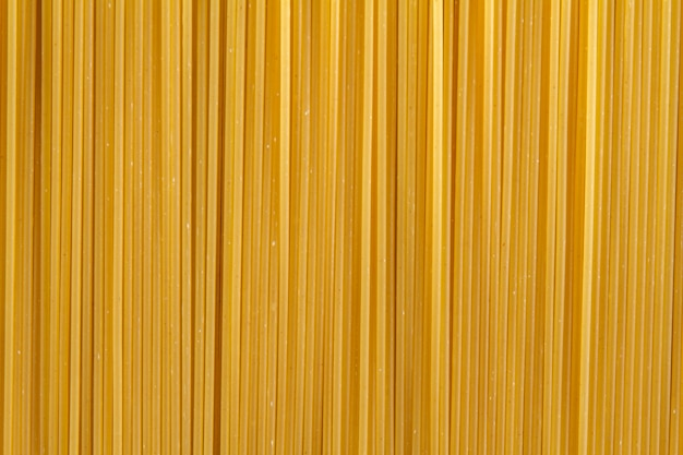 Close-up of uncooked spaghetti Free Photo