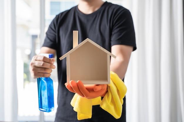 Close up  vacuum cleaner man cleaning at home Premium Photo