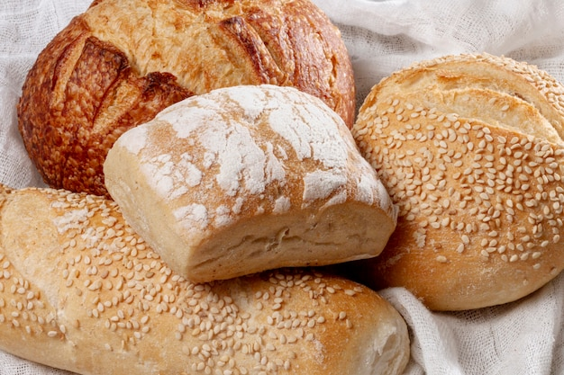 Close-up variety of baked bread Free Photo