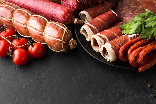 Close-up variety of fresh meat on the table Free Photo