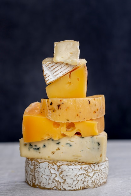 Close-up variety of tasty cheese Free Photo