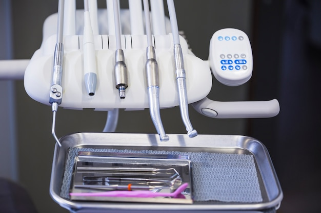 Close-up of various dental tools in clinic Free Photo