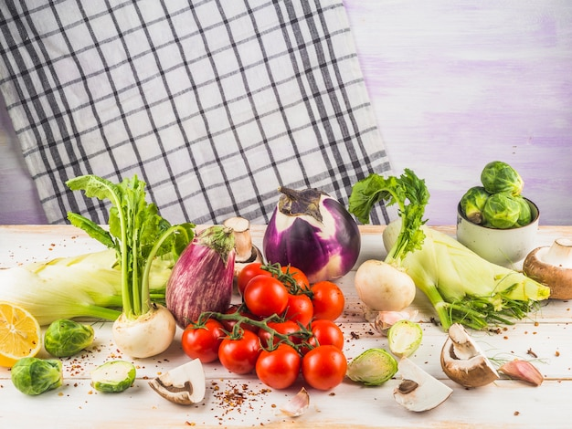 Close-up of various raw vegetables on wooden surface Free Photo