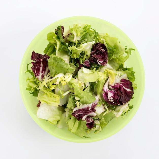 Close-up of vegetarian salad in green bowl Free Photo