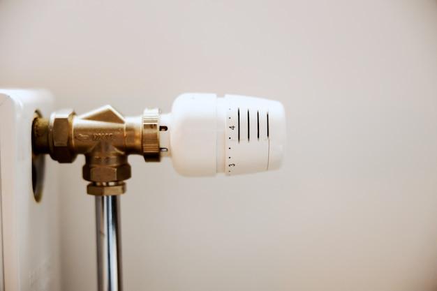 Close up of vent pipe on radiator in apartment. Premium Photo