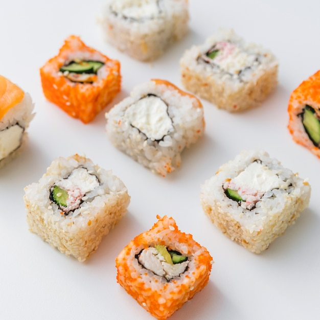Close up view of arranged assortments of sushi Free Photo