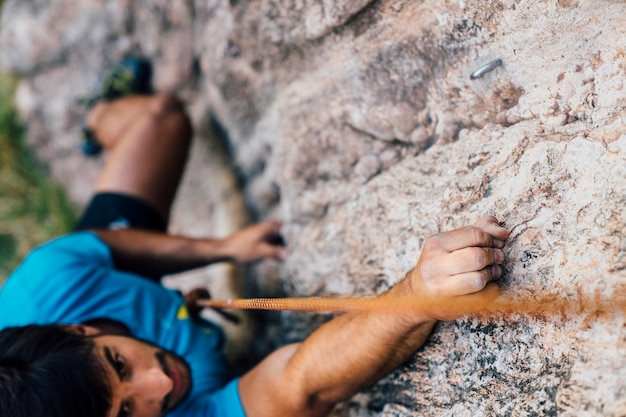 Close up view of climber on rock Free Photo