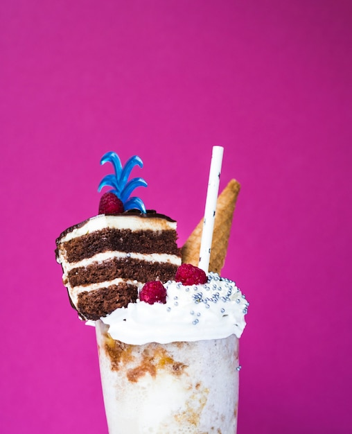 Close-up view of delicious milkshake with plain background Free Photo