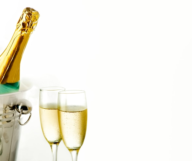 Close up view of glasses and champagne bottle in ice bucket Premium Photo