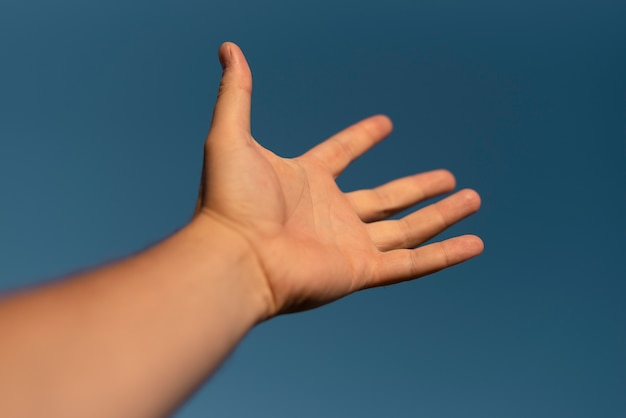 Close-up view of a hand in the air Free Photo