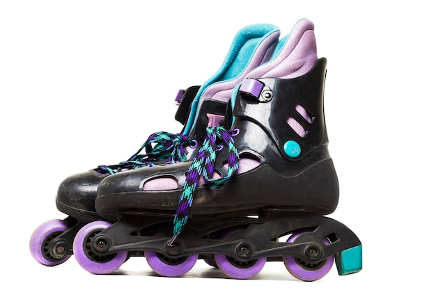 Close up view of inline skates isolated on a white background. Premium Photo