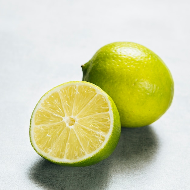 Close up view of lime on plain background Free Photo