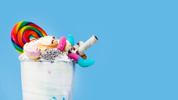Close-up view of milkshake on blue background with copy-space Free Photo