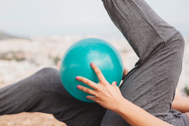 Close up view of woman doing exercise with ball 23 2147662201