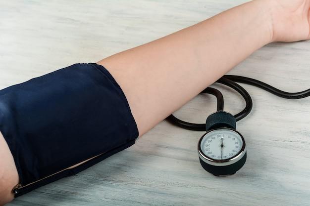 Close up view of person measuring his blood pressure Premium Photo